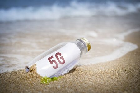 G5 written as massage in a bottle washed ashore and layed on the sand