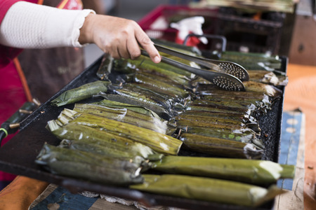 Baked glutinous wrap with leaf. know as PULUT PANGGANG in Malaysia