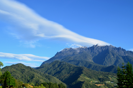 view of mount Kinabalu peak with beautiful cloud formation.Mount Kinabalu is a mountain in Sabah, Malaysia.