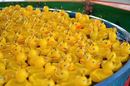 rubber duck in a pool. A rubber duck is a toy shaped like a stylized duck, generally yellow with a flat base. It may be made of rubber or rubber-like material such as vinyl plastic