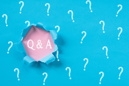 Blue torn paper with question mark revealing Q&A word. Questions and Answers concept background.