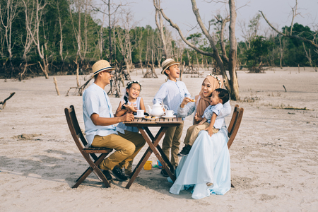 happy asian family having a good moment of happiness picnic outdoor. family,love and relationship concept