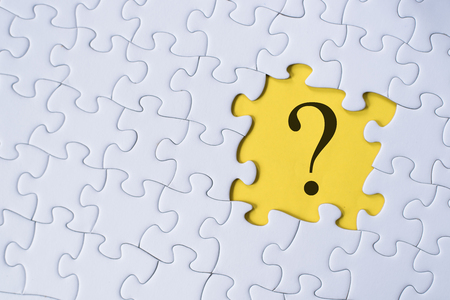 question mark on jigsaw puzzle with yellow background. question, faq and q&a concept