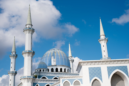 view of a beautiful Sultan Ahmad Shah public mosque with blue dome located in KuantanPahang,Malaysia 写真素材