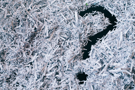 Heap of shredded paper with a symbol of question mark. concept of Questions and secret