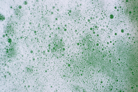 Full frame image of a bubbles or foamy soapy water for background. Concept of abstract and hygiene Фото со стока