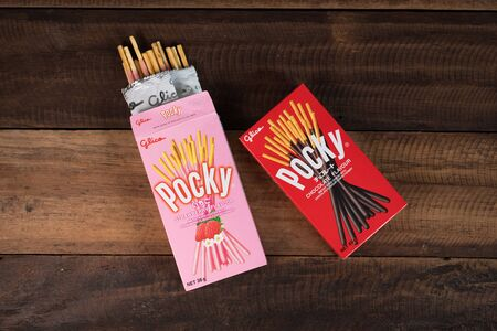 Petaling jaya, Selangor, Malaysia - 20 Oktober 2019 : Pocky brand of chocolate sticks on wooden background. Pocky is a famous confectionery among asian people