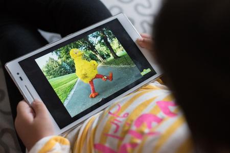 Petaling Jaya, Selangor, Malaysia - 03 November 2019 - Little girl wathing Sesame Street on a digital tablet. Sesame Street is a longtime favorite of children and adults