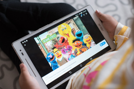 Petaling Jaya, Selangor, Malaysia - 03 November 2019 - Little girl wathing Sesame Street on a digital tablet. Sesame Street is a longtime favorite of children and adults