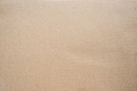 Brown corrugated cardboard box with grained tecture background. Concept of packaging and shipping