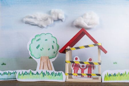 Hand drawn of trees, grass and a family inside a house. Concept of Lockdown in a global crisis pandemic