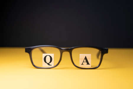 Q and A alphabet through an eyeglass. Concept of questions and answers Stock Photo