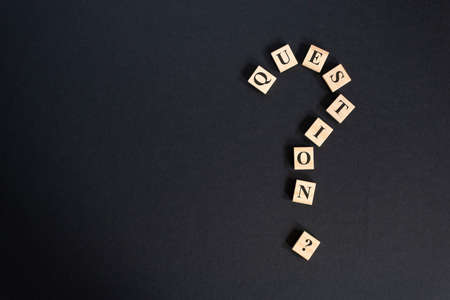 question mark word tiles arranged forming bigger question mark. question mark on black background Stock Photo