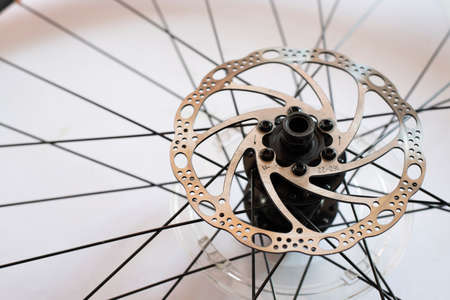 Bicycle brake disc on white background. Concept of safety