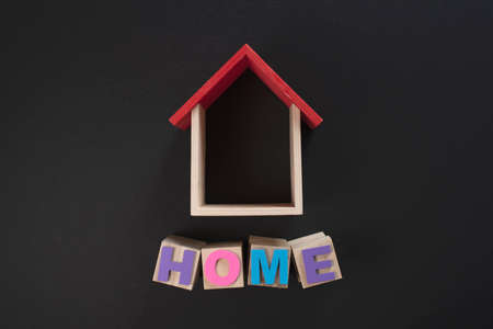 House shape with words HOME. Concept of buying a house Stock Photo