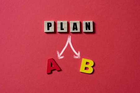 Wooden alpahabet tiles with plan A or B. Concept of planning and business