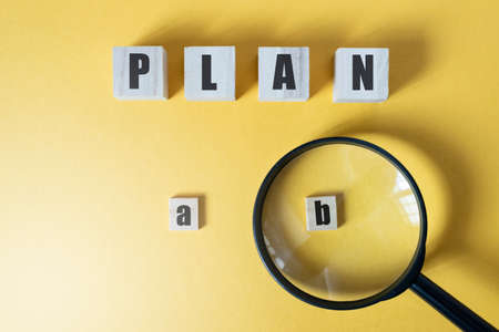 Magnifying zoom on Plan B against yellow background. Concept of Strategy, business management and option