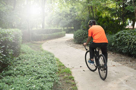 man riding bicycle in a park. Concept of healthy lifestyle and leisure activity