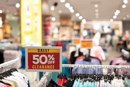 Label displaying 50 Percent off in a clothing outlet. Concept of Shopping, marketing and holiday sale