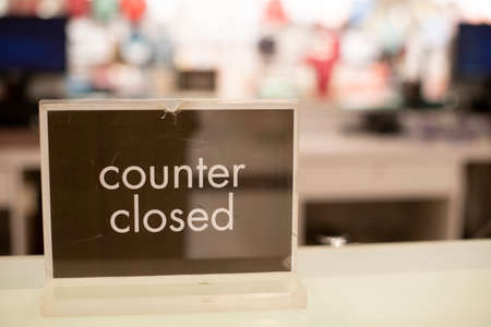 Counter Closed sign on a cashier table. Concept of business, economy and pandemic Stock Photo