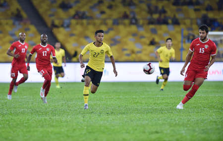 Kuala Lumpur, Malaysia - September 10, 2019 : Malaysia and Jordan player in action during FIFA World Cup Qatar 2022 and AFC Asian Cup China 2023 Preliminary Joint Qualification Round 2 at National Stadium Bukit Jalil. 에디토리얼