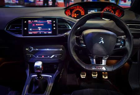 KUALA LUMPUR, MALAYSIA - DEC 3, 2019 : View of steering and interior new Peugeot 308 GTI displayed at Kuala Lumpur International Motor Show 에디토리얼
