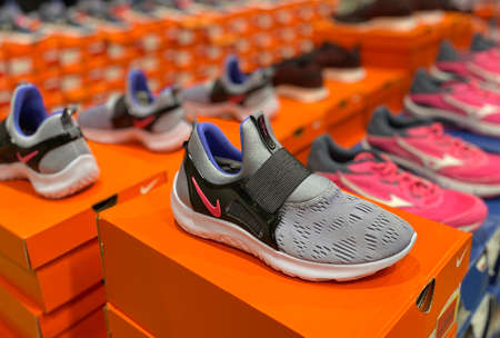 Kuala Lumpur, Malaysia - May 18, 2020 : Row of Nike sport shoes on display in local sports outlet Editorial