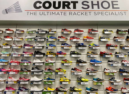 Kuala Lumpur, Malaysia - May 18, 2020 : Row of Badminton and court shoes on display in local sports outlet