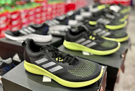 Kuala Lumpur, Malaysia - May 18, 2020 : Row of Adidas sport shoes on display in local sports outlet Editorial