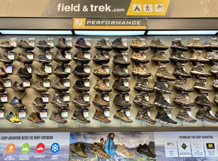 Kuala Lumpur, Malaysia - May 18, 2020 : Row of Hi-Tec hiking sports shoes on display in local sports outlet