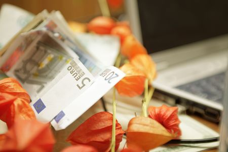 the gifts: money, flowers and laptop photo