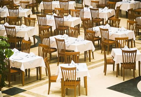 The covered tables in restaurant before supper Stock Photo - 650179