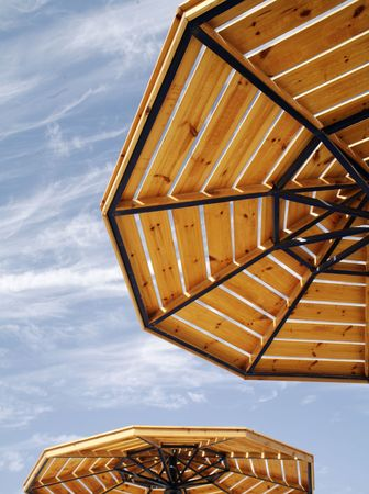 parasols on a cloudy sky. Ordinary picture of the rest. Stock Photo - 678541