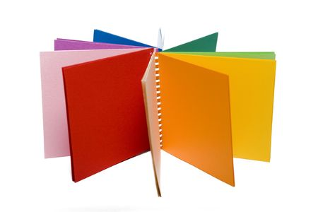 Colour pencils and colored  notebook lying like the sun. Isolated