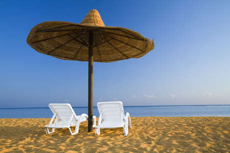 parasol and sunbeds on sand Stock Photo - 990093