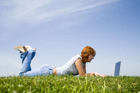 young girl with laptop on the grass (2) Stock Photo - 1104142