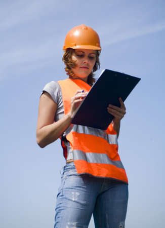 young girl with a helmet and emergency vest Stock Photo