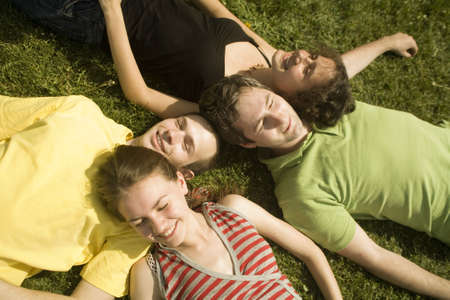 group of young friends on the grass Stock Photo