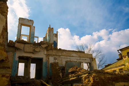 home destruction: destroyed bulding under blue sky Stock Photo