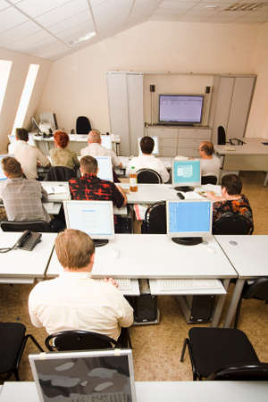 classroom training: computer class with some students Stock Photo