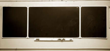 back view student: a clear school blackboard with sponges Stock Photo