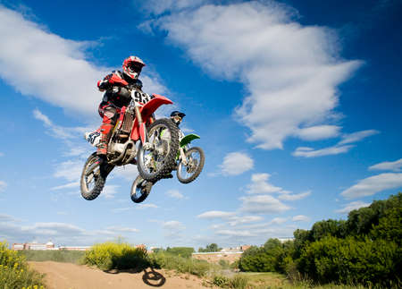 simultaneous: simultaneous jump of two motocross riders