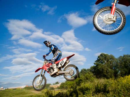 motorsprot: the motocross riders in the air Stock Photo