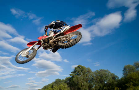 motocross rider jumping over me! Stock Photo