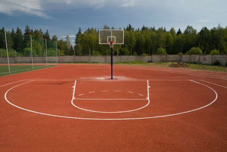 gymnasium: outdoor red basketball stadium. Red, green, blue :) Stock Photo