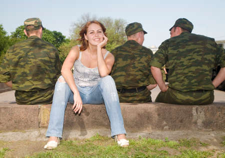 the girl and three military backs Stock Photo - 1478725