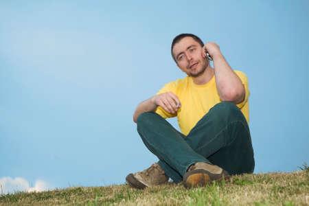smoking man sitting on the grass Stock Photo - 1478714