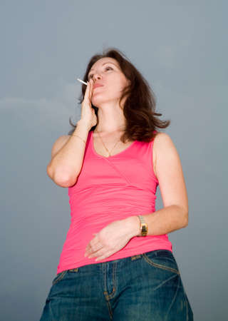 smoking woman and storm-cloud Stock Photo - 1478717