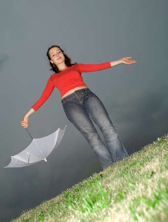 the girl and umbrella in her hand Stock Photo - 1478715