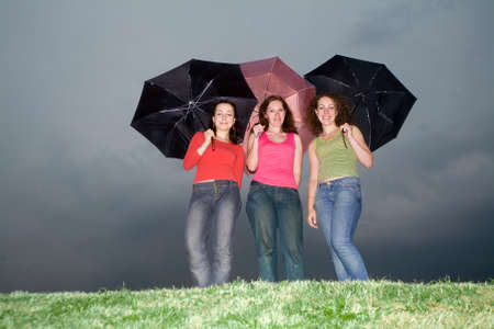 three playmate with umbrellas Stock Photo - 1478716